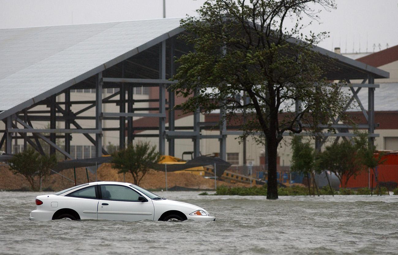 A car drifts in a flood.