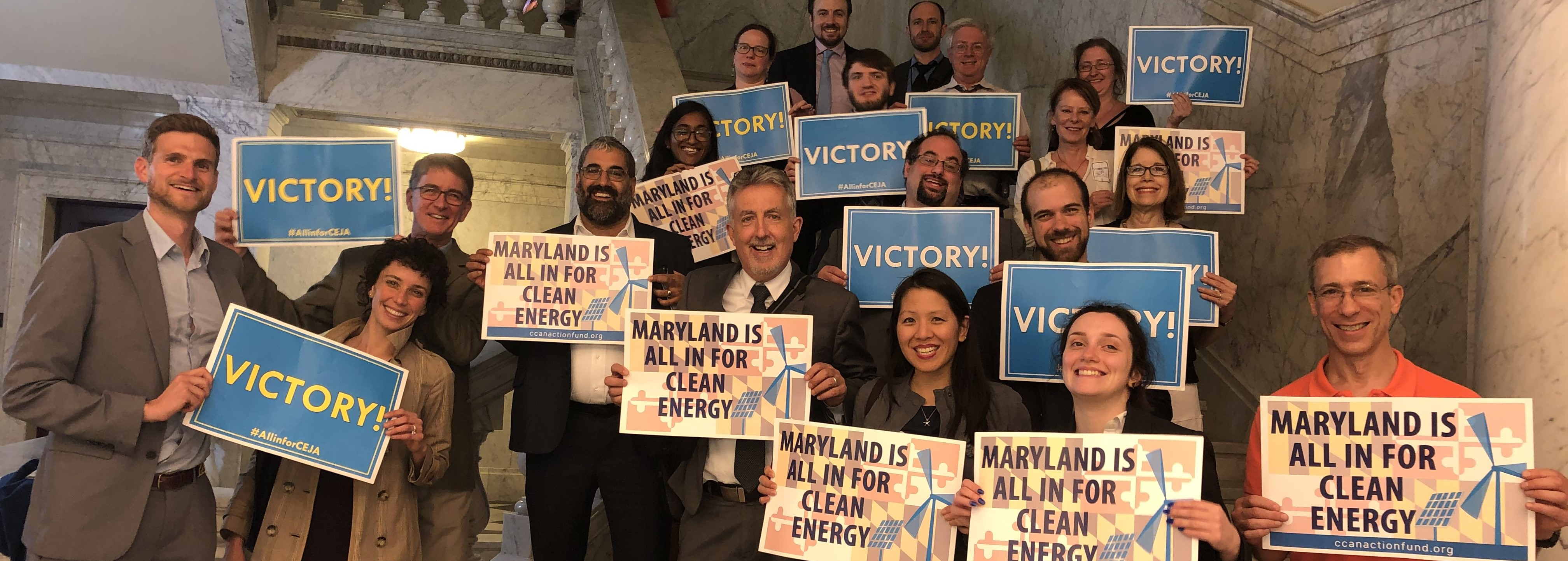 CCAN staff, interns and supporters pose for a victory shot right after the passage of the Clean Energy Jobs Act.