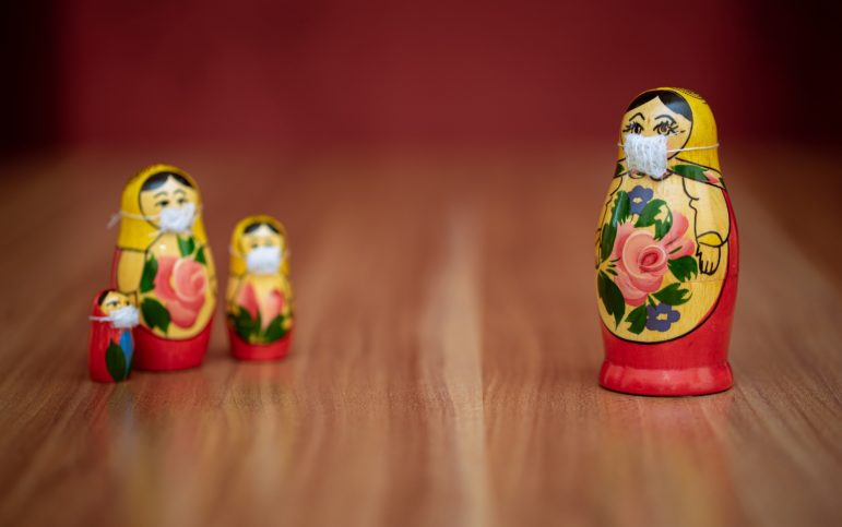 socially-distanced Russian matryoshka dolls with face masks