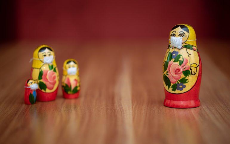 socially-distanced Russian matryoshka dolls with face masks